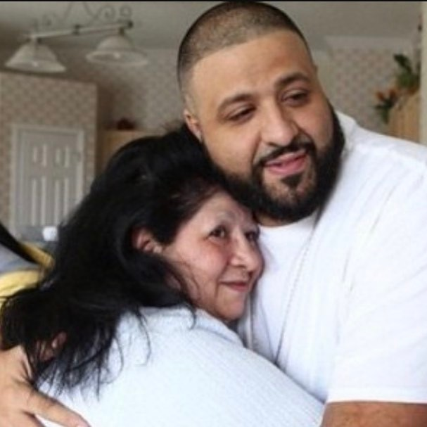 Dj Khaled and his mother hugging each other.